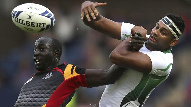 Srinath Sooriyabandara of Sri Lanka and Allan Seamus Otim of Uganda fight for the ball.