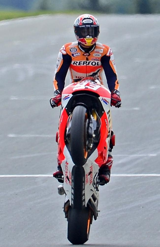 Marc Marquez performs a wheelie after winning the race in Hohenstein-Ernstthal, eastern Germany.