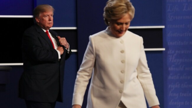Hillary Clinton leaving the podium at the third debate in a white pantsuit. Photo: AP