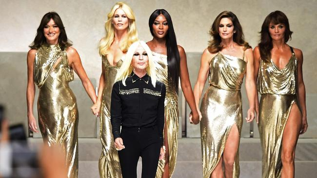Bruni, Schiffer, Campbell, Crawford and Christensen pose with Italian designer Donatella Versace. Picture: AFP / Miguel Medina.