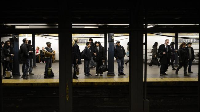 Commuters wait at the 59th Street subway station in New York. Photo: AFP/TIMOTHY A. CLARY