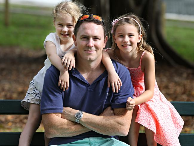 Will Anderson, with his daughters Olivia, four, and Charlotte, seven, is the only dad at daytime school activities. Picture: Annette Dew