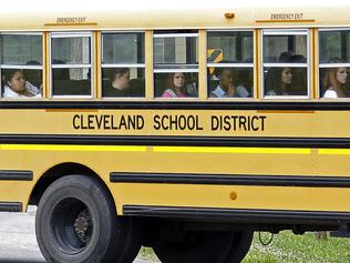 FILE- In this May 13, 2015 file photograph, an integrated group of Cleveland, Miss., public school students ride the school district bus on their way home following classes. A federal judge ruled on a desegregation case, Friday, May 13, 2016, that the Cleveland school district must merge its high schools and middle schools to achieve racial desegregation. (AP Photo/Rogelio V. Solis, File)