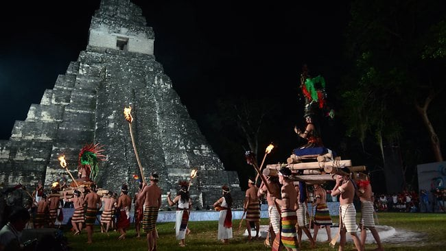 A folkloric group performs during celebrations marking the end of the Mayan age, December 20, 2012 at the Tikal archaeological site, Peten departament, 560 kms north of Guatemala City. AFP PHOTO / Johan ORDONEZ