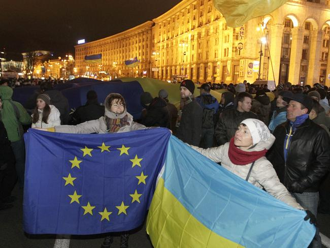Looking to Europe ... activists hold European Union and Ukrainian flags during a meeting to support European Union integration at European Square in Kiev, Ukraine last year.. Picture: Sergei Chuzavkov