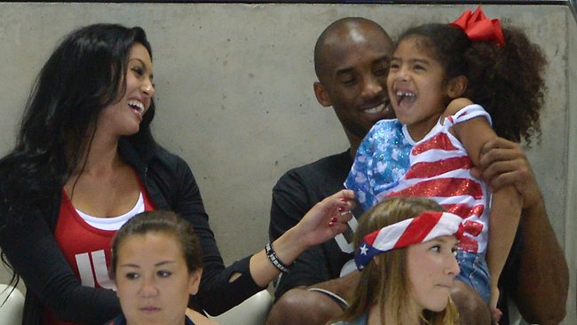 Kobe Bryant with his wife Vanessa and daughter Gianna prepare to watch the final night of swimming at the Aquatics Centre. (AP Photo/Mark J. Terrill)