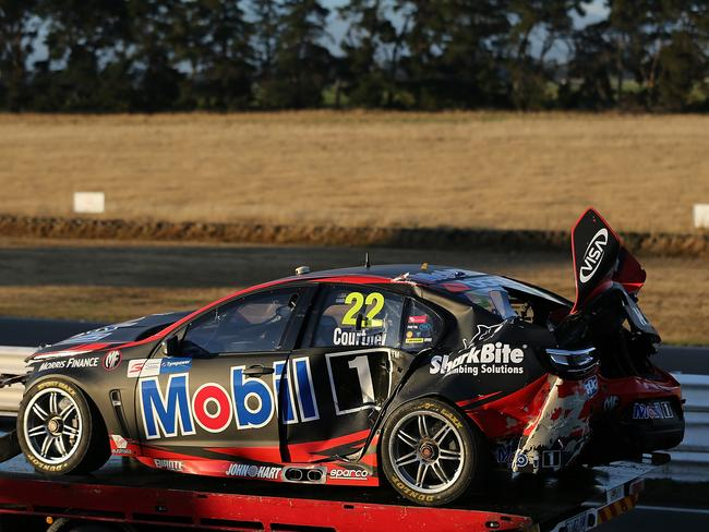 James Courtney's car is removed from the Symmons Plains Raceway. Picture: Getty Images
