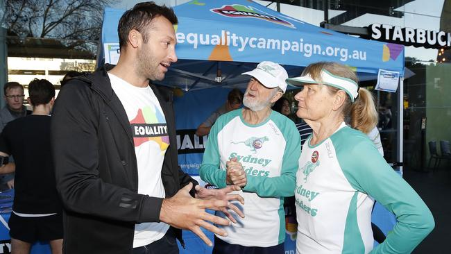Swimming legend Ian Thorpe talks to runners in Sydney's City2Surf about same-sex marriage on Sydney morning. Picture: AAP Image/Daniel Munoz.
