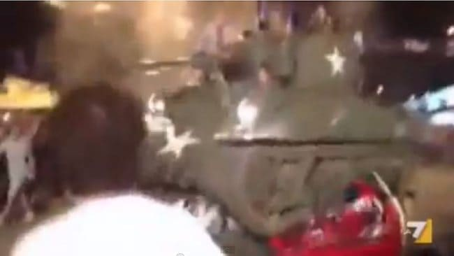 A screen grab of a video showing a tank driven by Atalanta fans that drove over two cars decorated in the colours of rival teams Brescia and Roma.