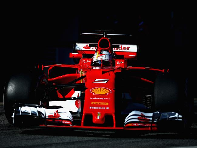 Sebastian Vettel of Germany driving the (5) Scuderia Ferrari SF70H leaves the garage during day one of Formula One winter testing at Circuit de Catalunya.