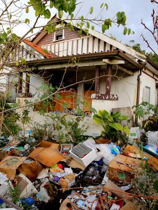 Mary Bobolas, whose house is pictured after rubbish accumulated again, says she cooks and bakes cakes inside. Picture: Stephen Cooper