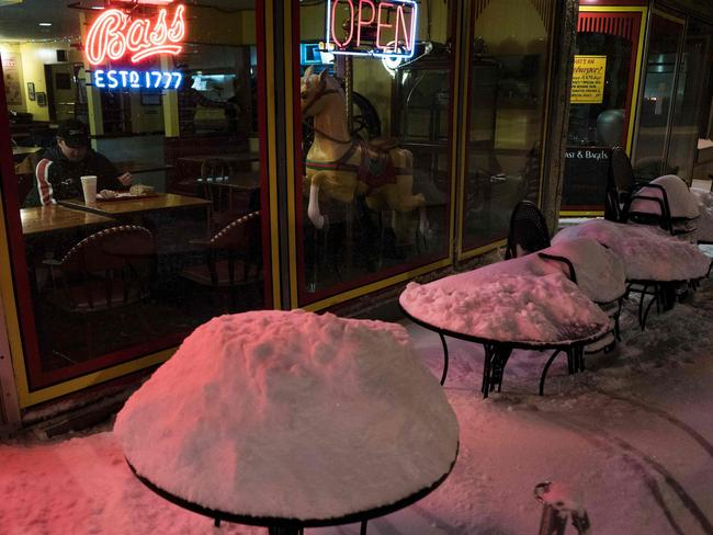 Some cafes remained open, but it wasn't exactly easy to find a way inside. Picture: Brendan Smialowski