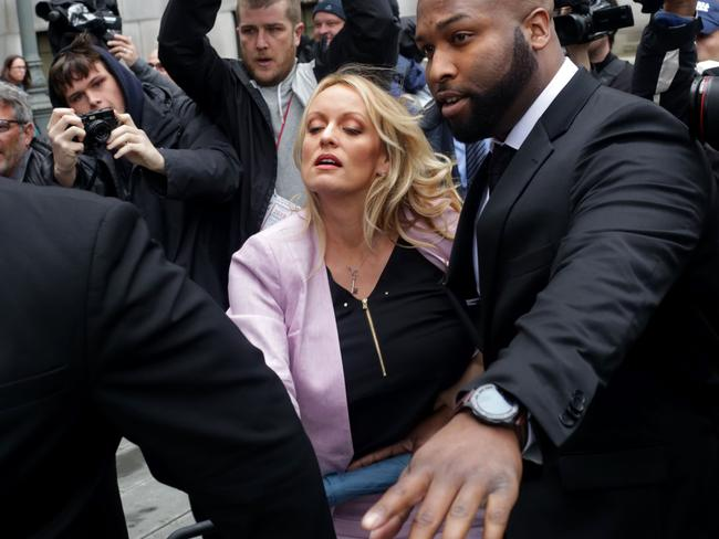 Daniels slipped and almost fell on the wet pavement as she arrived for a court hearing for Trump's personal lawyer Michael Cohen in New York. Picture: AFP