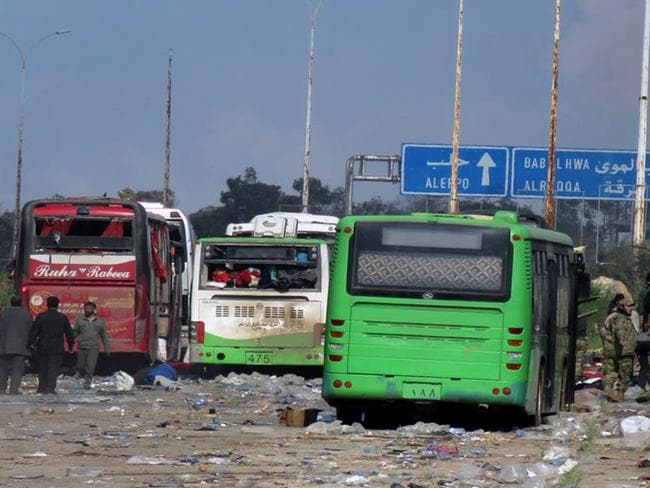 Buses at the evacuation point where an explosion hit at the Rashideen area, a rebel-controlled district outside Aleppo city, Syria. Picture: AP