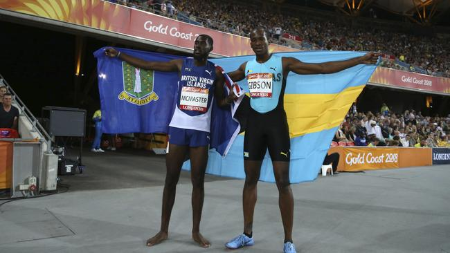 Kyron Mcmaster of the British Virgin Islands, left, and the Bahamas' Jeffery Gibson celebrate their gold and silver medals