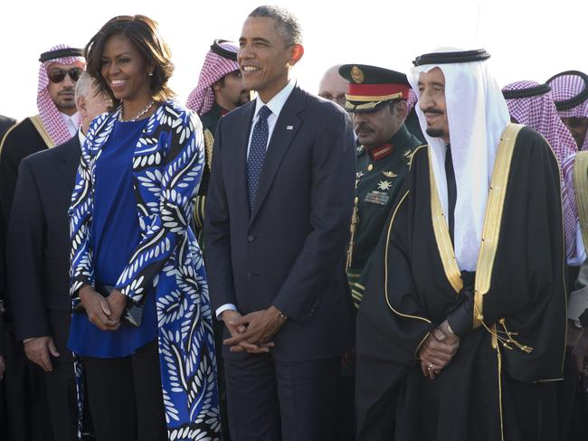 2015: President Barack Obama and first lady Michelle Obama stand with new Saudi King Salman bin Abdul Aziz they arrive on Air Force One at King Khalid International Airport, in Riyadh, Saudi Arabia. Picture: Carolyn Kaster)