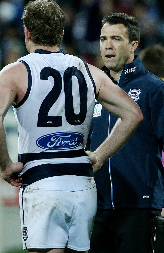 Chris Scott talks with Steve Johnson. Picture: Colleen Petch.