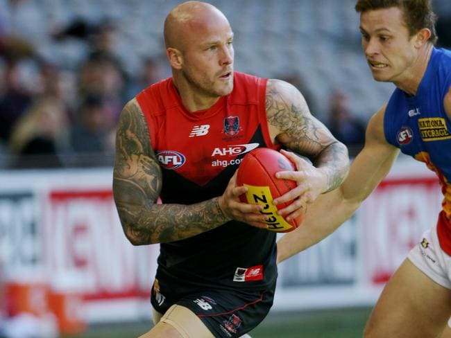Melbourne co-captain Nathan Jones with the ball against Brisbane. Picture: Colleen Petch