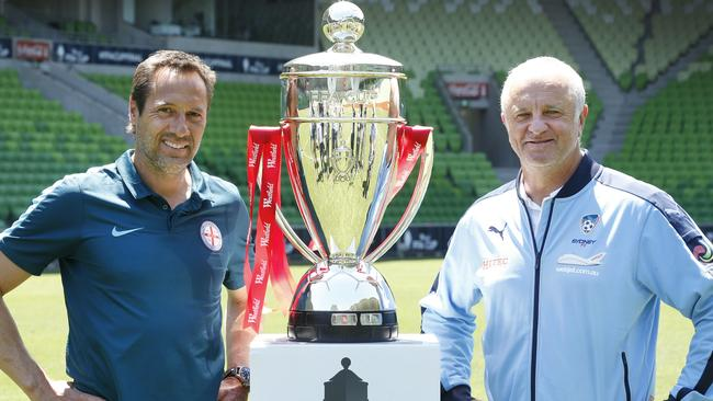 Melbourne City coach John van 't Schip and Sydney FC coach Graham Arnold with the FFA Cup. Picture: David Caird