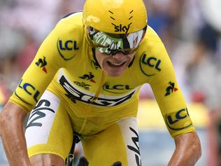 TOPSHOT - Great Britain's Christopher Froome wearing the overall leader's yellow jersey crosses the finish line at the Velodrome stadium at the end of a 22,5 km individual time-trial, the twentieth stage of the 104th edition of the Tour de France cycling race on July 22, 2017 in and around Marseille, southern France. / AFP PHOTO / PHILIPPE LOPEZ