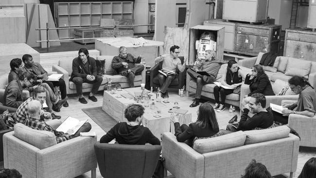 The new crew ... Writer/Director/Producer J.J. Abrams (top centre in glasses) conducts a cast reading for Star Wars: Episode VII with Harrison Ford, Daisy Ridley, Carrie Fisher, Peter Mayhew, Producer Bryan Burk, (producer) Kathleen Kennedy, Domhnall Gleeson, Anthony Daniels, Mark Hamill, Andy Serkis, Oscar Isaac, John Boyega, Adam Driver and (writer) Lawrence Kasdan. Picture: David James