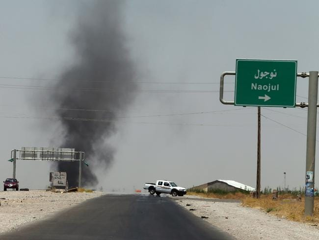 Ongoing campaign ... Smoke billows from an area controlled by ISIS between the Iraqi towns of Naojul and Tuz Khurmatu, both located north of the capital Baghdad.