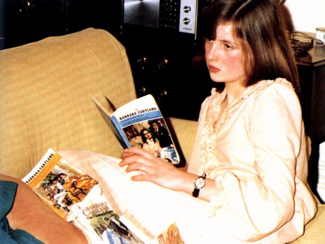 Diana reading copies of her step-grandmother Barbara Cartland's latest novels at Althorpe, featured in Andrew Morton's latest book, Diana, Her True Story, In Her Own Words. Royals Picture: Supplied