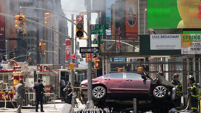 A wrecked car sits in the intersection of 45th and Broadway in Times Square. Picture: Drew Angerer/Getty Images/AFP