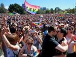 Marriage Equality supporters gather at Prince Alfred Park in Surry Hills ahead of the plebiscite announcement. Supporters react to the Yes announcement. Picture: Toby Zerna