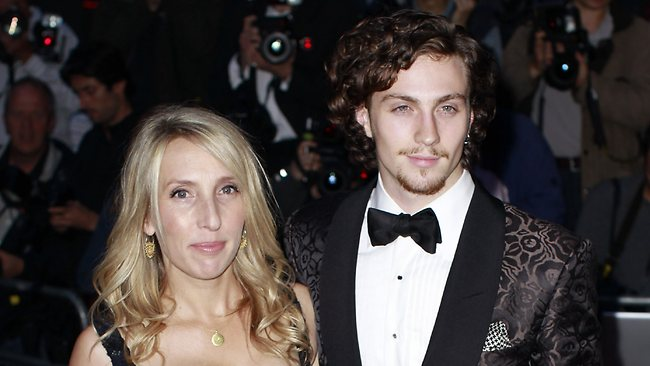 British artist Sam Taylor-Wood, left, and her husband Aaron Taylor-Johnson arrive for the GQ Awards in London in 2010.