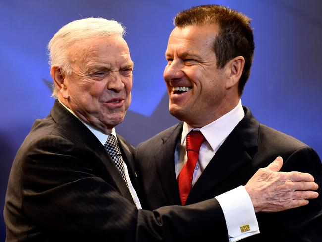 Carlos Dunga (R) greets president of the Brazilian Football Confederation (CBF), Jose Maria Marin during a press conference to announce Dunga as the new coach of Brazil.