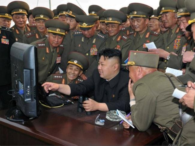 North Korean leader Kim Jong-Un looking at a computer as he inspects a long-range artillery sub-unit. Picture: AFP KCNA via KNS