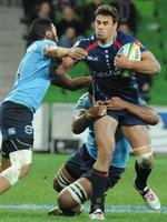 Clamped ... The Rebels' Tom English is tackled by the Waratahs' Alofa Alofa during the clash at AAMI Park on Friday. Picture: Andrew Henshaw