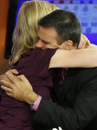 WDBJ-TV7 news morning anchor Kimberly McBroom, left, hugs meteorologist Leo Hirsbrunner after their early morning newscast. Picture: AP Photo/Steve Helber