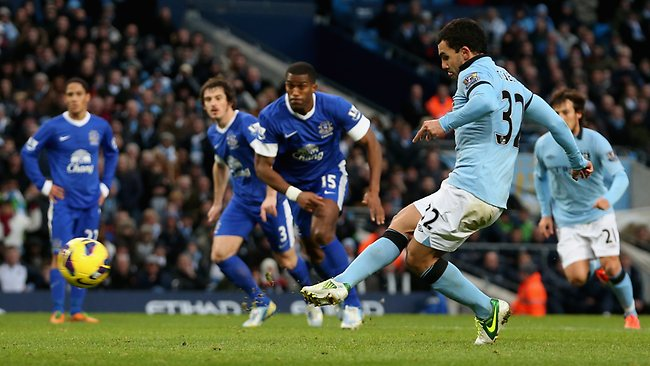 Carlos Tevez scores for Manchester City from a penalty to level the score at 1-1 against Everton at the Etihad Stadium. Picture: Scott Heavey