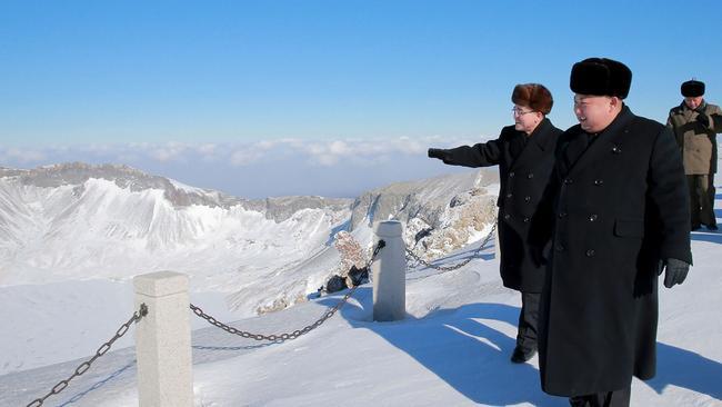 Kim Jong-un strolls the mountain with officials. Picture: KCNA via KNS/AFP