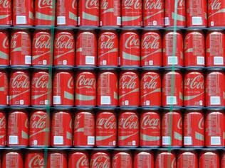 (FILES) This file photo taken on February 9, 2017 shows pallets of Coke-Cola cans waiting to be shipped out at a Coco-Cola bottling plant in Salt Lake City, Utah. Coca-Cola reported lower earnings on April 25, 2017 on restructuring costs and flat volumes as it touts new low-sugar beverages in response to flagging demand for soda.Net income in the first quarter was $1.2 billion, down 20.3 percent from the year-ago period. / AFP PHOTO / GETTY IMAGES NORTH AMERICA / GEORGE FREY