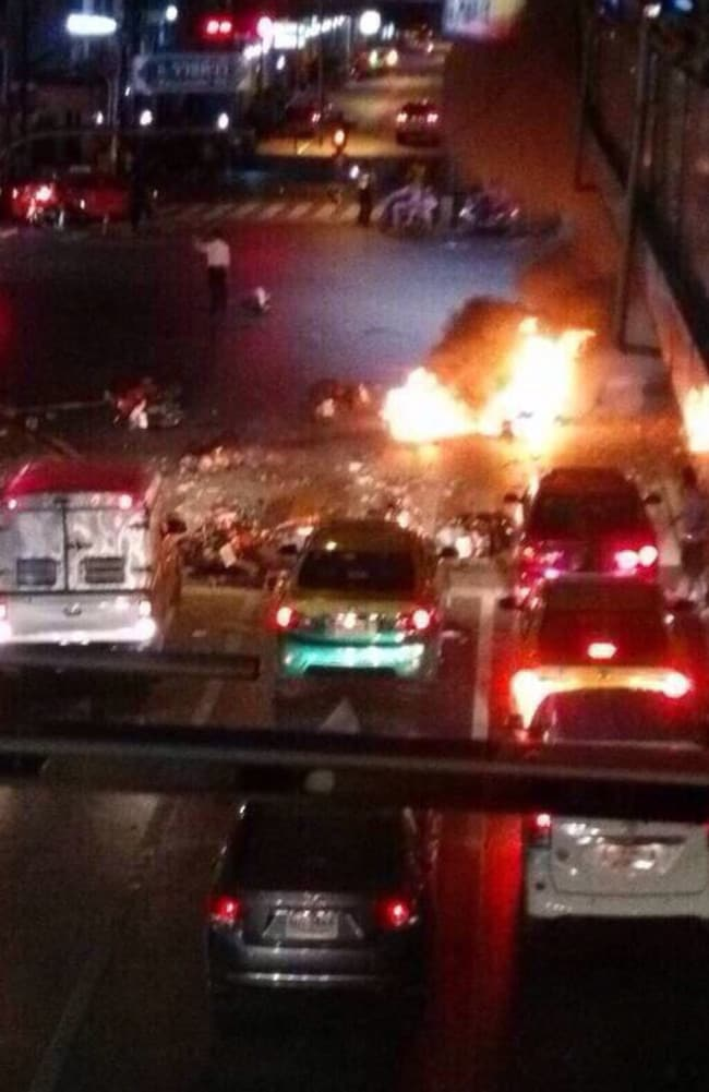 Flashpoint ... Motorbikes burn in the middle of a busy intersection moments after the explosion. Picture: Supplied