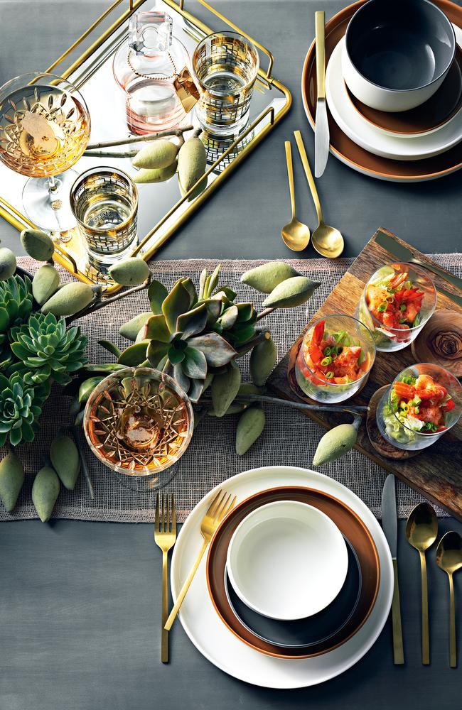 Darren Palmer brings nature to his Christmas table along with brass for a touch of luxury. Photography by Edward Urrutia. Styling by Aleksandra Beare.