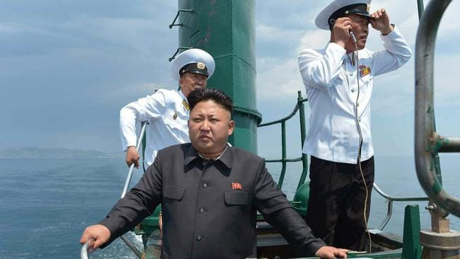 North Korean leader Kim Jong-un aboard a submarine during his visit to the North's Naval Unit 167 stationed on the east coast in 2014. Parts of the vessel's observation tower appear to be rusted. Picture: AAP Image/Yonhap News Agency