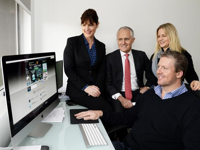 Communications Minister Malcolm Turnbull (centre) inspects the new NBN service at a Umina Beach home.