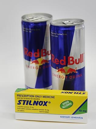 Prescription sleeping tablet drug Stilnox pictured with cans of energy drink Red Bull.