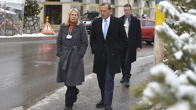 Prime Minister Tony Abbott with Deputy Secretary of the Department of Foreign Affairs Dr Heather Smith in Davos Switzerland. Picture: John Tass-Parker