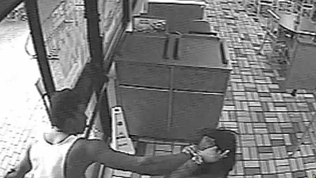 Sickening attack ... the man drags his victim by the hair from the Burger King restaurant after dunking her head in a toilet.