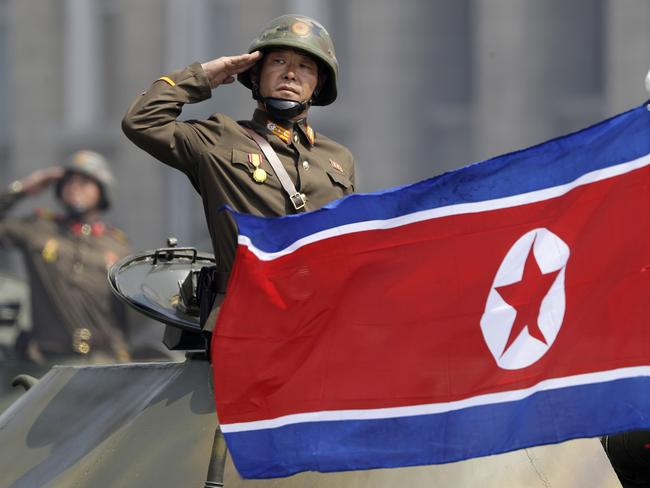 A North Korean national flag flutters as soldiers in tanks salute to North Korean leader Kim Jong Un during a military parade in Pyongyang, North Korea. Picture: AP