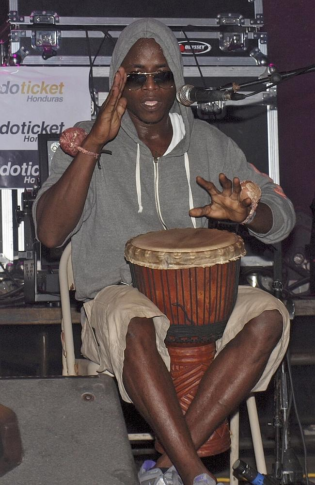 Suspect ... Lenin Roberto Arana, whose stage name is Canario (The Canary), plays a traditional Garifuna drum during a concert in Roatan, Honduras. Picture: AP/Bay Islands Voice, Robert Armstrong