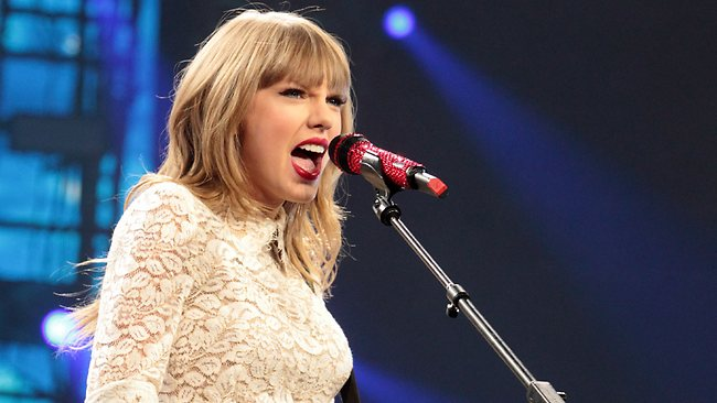 Taylor Swift has cut the opening ribbon after donating $US4 million to build a music education centre at Nashville's Country Music Hall of Fame. Picture: AP