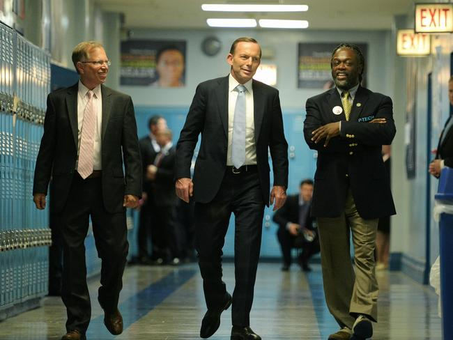 An Eduction ... Mr Abbott is joined by Stanley Litow from IBM and School principal Rashid Ferrod Davis during his visit to the Pathways in Technology Early College High School in Brooklyn. Picture: Jake Nowakowski