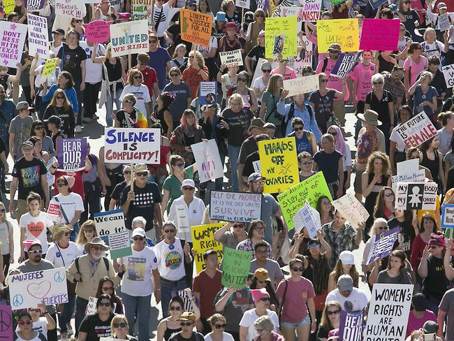 Millions of women around the world marched for women's rights against Donald Trump at the weekend. Picture: Ralph Barrera/Austin American-Statesman via AP