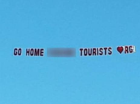 tourists told to go home in stunt.